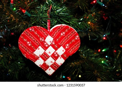 Handmade Woven Red and White Heart Ornament Hanging on the Christmas Tree