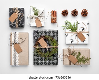 Handmade wrapped christmas gift boxes on white background. Top view, flat lay.