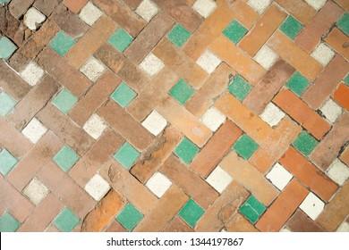 The handmaiden bricked pavement. Granada, Spain