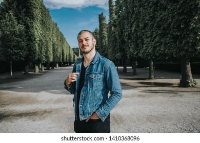 Handosme bearded man posing in park in Vienna