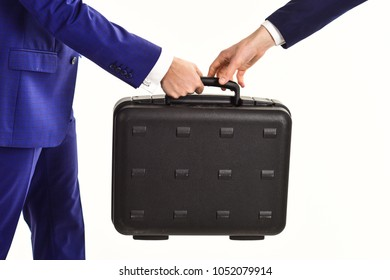 Handover of case in hands of business partners, isolated on white background. Business transfer concept. Male hands in suits hold briefcase. Male hands carry briefcase for exchange or cashing out.