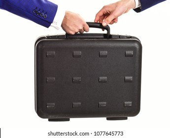 Handover of case in hands of business partners, isolated on white background. Business exchange concept. Male hands in suits hold black briefcase, close up. Male hands carry briefcase for exchange.
