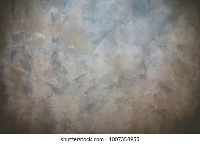A hand-painted abstract background in shades of blue, tan and gray.