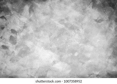 A hand-painted abstract background in shades of gray.