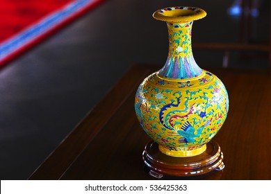 Hand-painted Chinese yellow vase on the table. China. The hotel complex