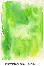 Hand-painted watercolor abstract background in green and yellow green with cream-colored, rough watercolor paper texture.