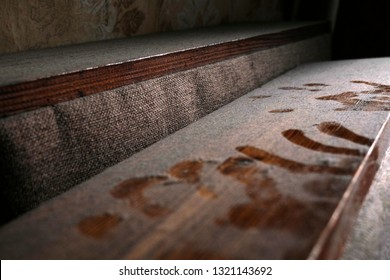Handprint on dusty wooden surface. Old abandoned house with furniture horror