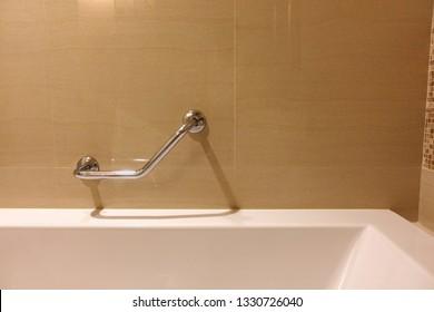 Handrails in the bathtub,  Disability Access Bathtub.