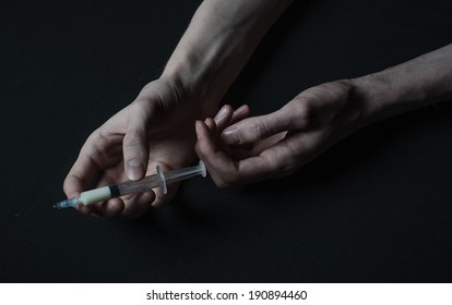 hands addict syringe