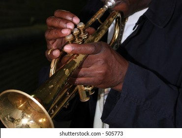 Hands of an African American man playing the trumpet
