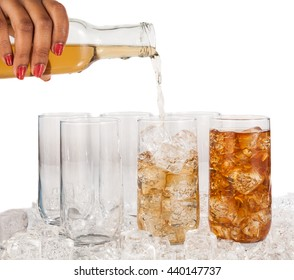 Hands of a African American woman pouring a drink in vessels