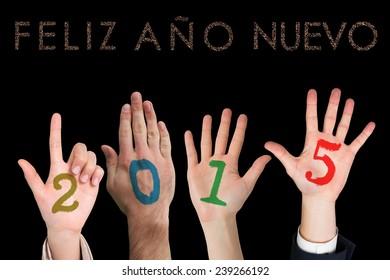 Hands against glittering feliz ano nuevo