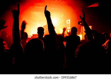 Hands in the air silhouette at nightclub party rave