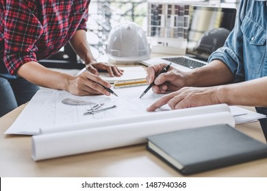Hands of architect or engineer working on blueprint meeting for project working with partner on model building and engineering tools in working site, Construction and structure concept.