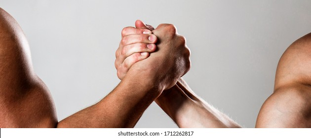 Hands or arms of man. Muscular hand. Arm wrestling. Two men arm wrestling. Rivalry, closeup of male arm wrestling. Two hands. Men measuring forces, arms. Hand wrestling, compete.