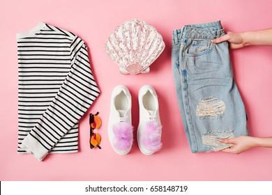 Hands Arranging Flat Lay Female Parisian Style Clothing