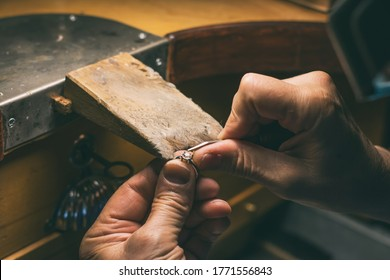 Hands of an artisan jeweler working jewelry. Jewelry Goldsmith