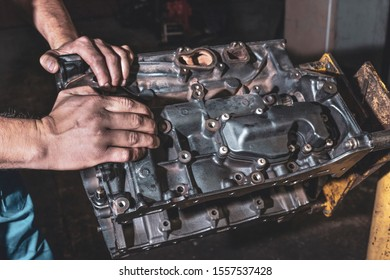 Hands auto mechanic, and engine close-up. Repair service.