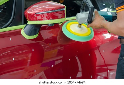 Hands with Auto polisher. Car wax