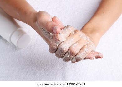 Hands beauty treatment with clay cream