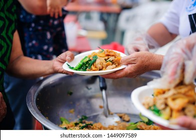 Hands of beggars accepting food from the hands of volunteers who come to help free food breaks : Social Problems of Poverty Helped by Feeding