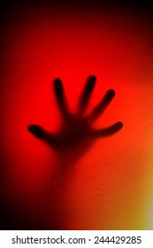 hands behind the frosted glass. fear, panic, scream concept.