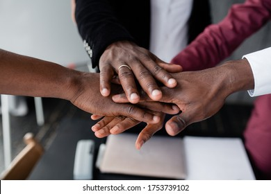 The hands of black people in the center hold each other to unite against racism in large countries. Black lives matter.
