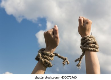 hands bound by rope