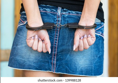 Hands bounded with handcuffs