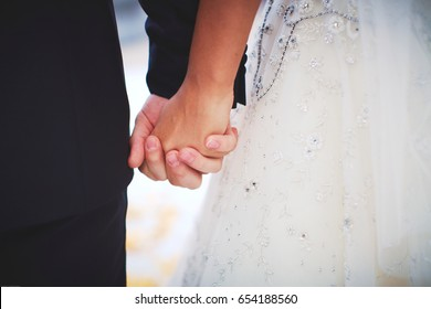 Hands of bride and groom close up