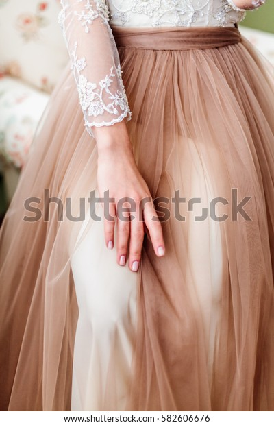 Hands of the bride on her knees