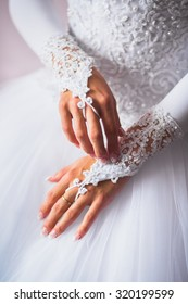 Hands of a bride with a wedding manicure