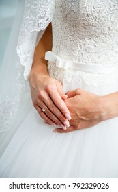 Hands of the bride with wedding ring