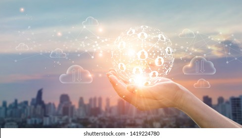 Hands of business holding global structure networking and data exchanges customer connection on sunset background