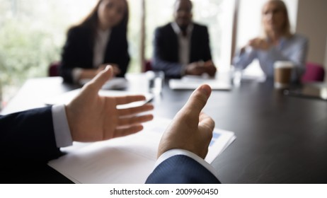 Hands of business leader, executive, boss, coach talking to diverse team, explaining marketing reports to employees, speaking before audience on office meeting, conference. Cropped banner, close up