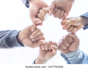 Hands of Business Partners Giving Fist Bump and collaboration concept of teamwork on white background