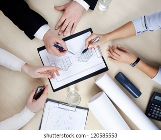 Hands of business people at the table at the meeting in the office. top view