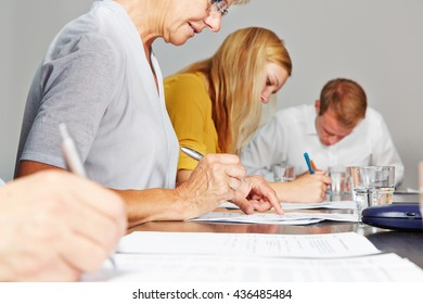 Hands of business people writing and signing contracts