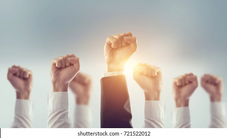 Hands of Business team raised fist air Corporate Celebration victory, success and winning concept. sunlight effect.
