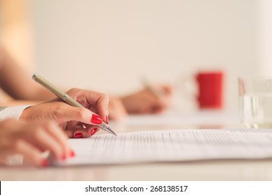 Hands of business woman working with papers