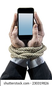 Hands of businessman addicted to mobile phone rope bond wrists in smartphone internet addiction and slave to online network addict concept isolated black background