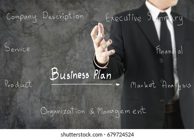 Hands of businessman in black suit drawing a business plan