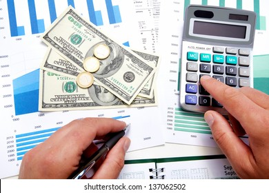 Hands of businessman with calculator. Finance and accounting business.