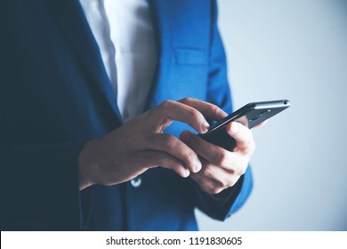 Hands of businessman calling by phone