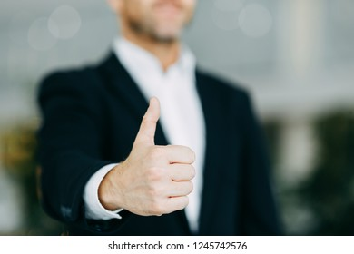 Hands of a businessman to design with a neutral photon. Okay, high five, palms and a successful man.
