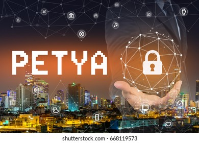 Hand's businessman holding security global network connection protected system from PETYA virus.