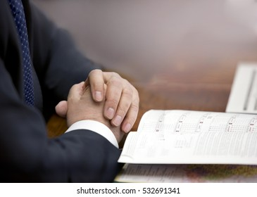 Hands of businessman with notebook on soft background