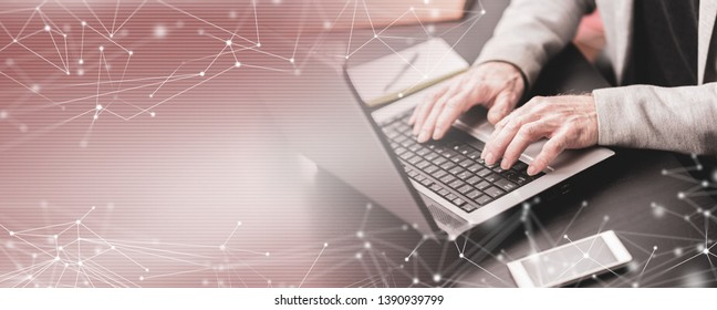 Hands of businessman using laptop at office; multiple exposure