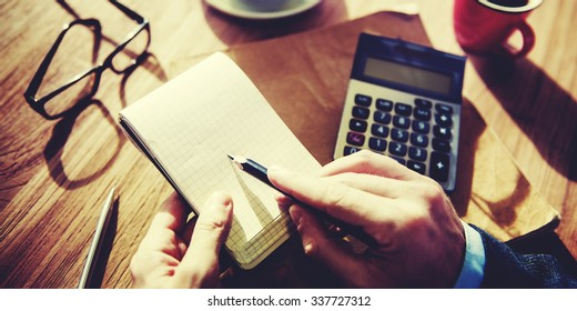 Hands of Businessman Working with Calculator Concept