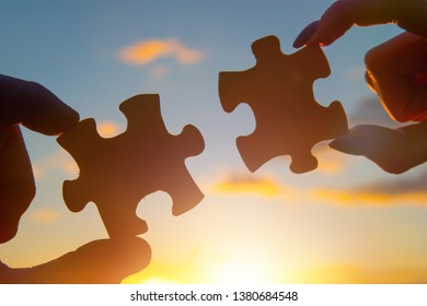 hands of businessmen assemble puzzle pieces. Business concept idea, cooperation, teamwork, innovation, creativity. strategy, friendship.